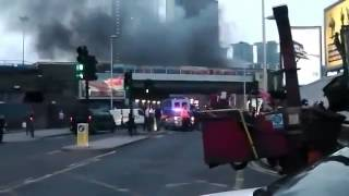 Helicopter Crash Near Vauxhall Cross - Emergency workers rush to the scene of a helicopter crash