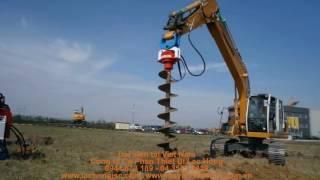 Máy khoan đất ruột gà lắp trên máy đào