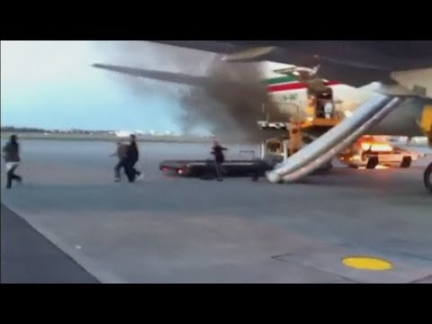 Dramatic plane blaze: Fire on tarmac sends passengers running from plane