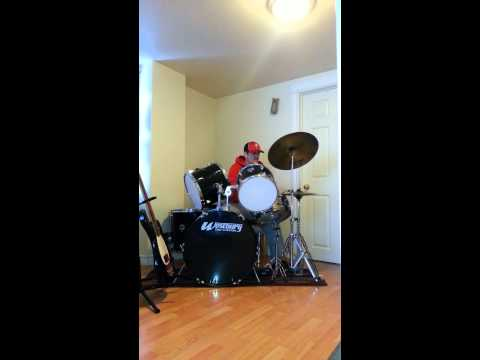 Playing drums with branches off a tree