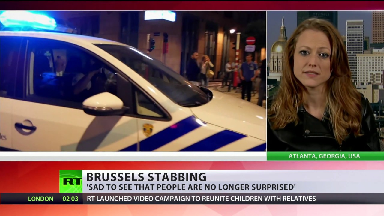Brussels stabbing: knife-wielding man shot dead by police