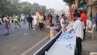 Mumbai Marathon 2017 HD Video.Cute Small Kids Providing Water Bottles to Runners.India.Indian Kid