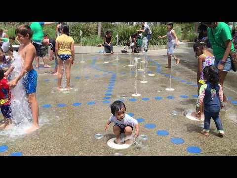 Toddler activity playing at water playground Darling Quarter Sydney Australia