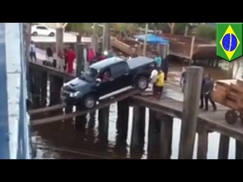 Cargo crew loads huge pickup truck onto ship using tiny toothpicks