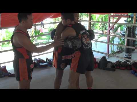 Tiger Muay Thai Techniques: Throw opponent from body lock clinch Image 1