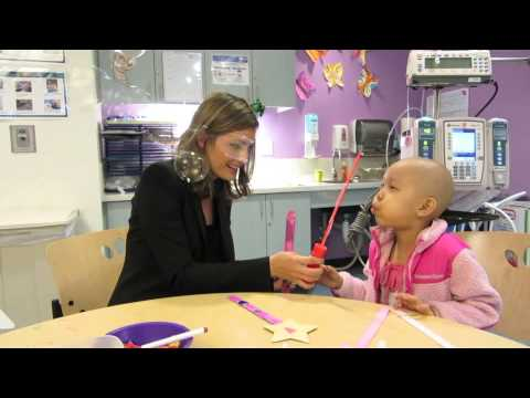 Stana Katic of ABC's Castle Blows Bubbles with Little Girl at Children's Hospital Los Angeles