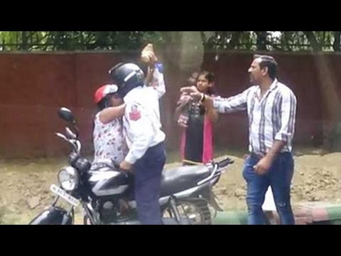 Delhi cop caught on camera attacking woman with brick