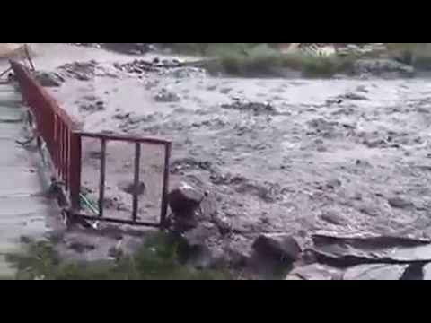 Грязевой поток рушит мост