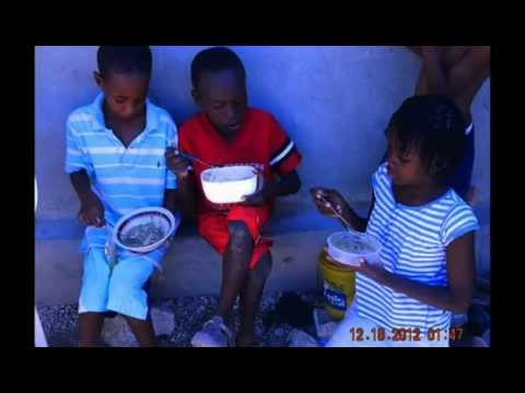 MaMa Maggie's youth sell water in Haiti..