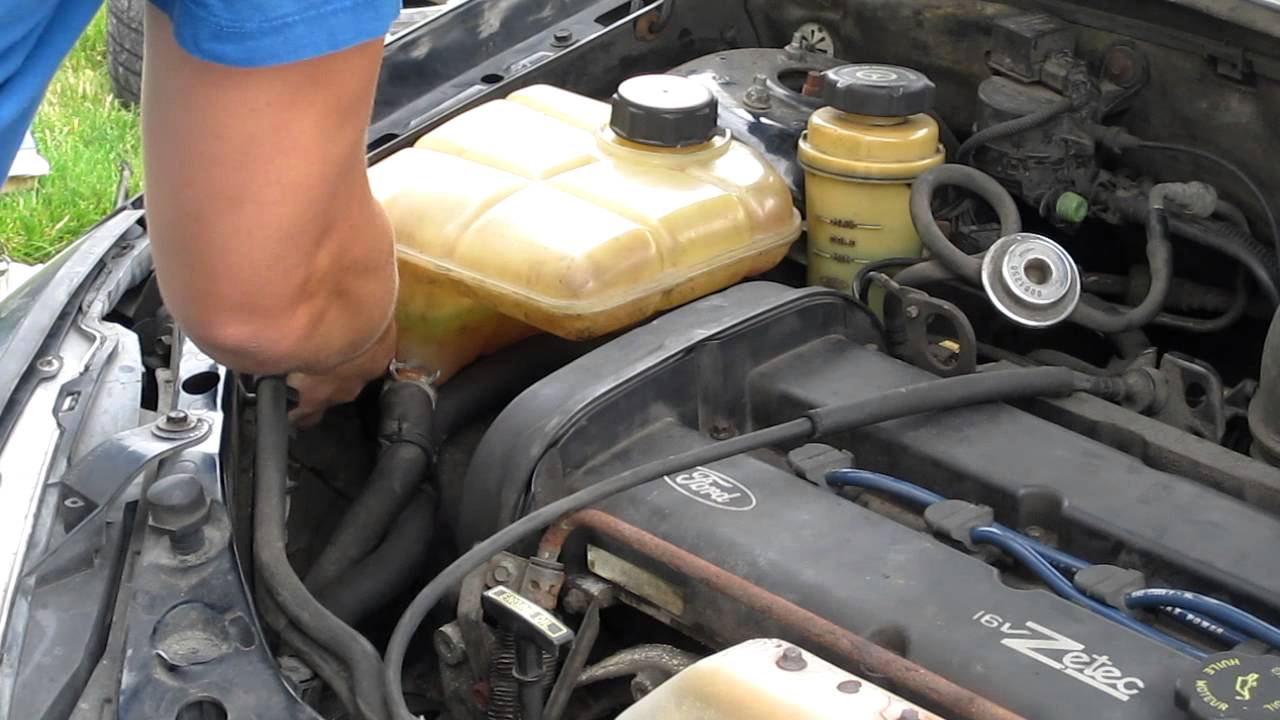 Ford focus coolant reservoir removal timing belt clip 2 youtube