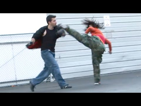Taekwondo Girl vs Boxing Guy Street Fight Scene Image 1