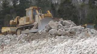 Dresser Dozer pushing rock