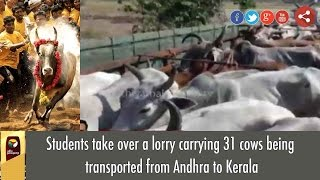 Students take over a lorry carrying 31 cows being transported from Andhra to Kerala