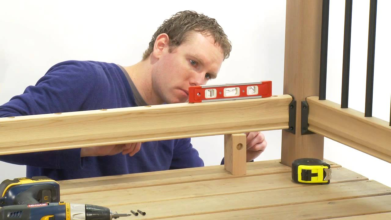How to install a rail simple traditional deck railing kit for Basic deck building instructions