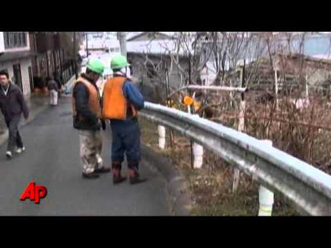Amateur video of the tsunami that hit Japan in March shows people running as ...