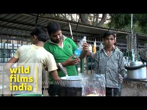 Tea lovers drink tea outside tea stall in Delhi