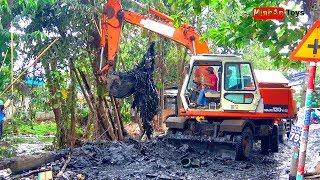 ExcavatorTruck: Excavator Digging Loading Dirt Into Truck