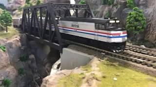 Amtrak Passenger Train Going Over The Nishna Valley Bridge