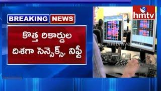 భారీ లాభాల్లో స్టాక్ మార్కెట్లు..! Sensex, Nifty Hit Record High  | hmtv