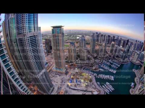 Dubai marina harbor panorama from night to day transition timelapse fisheye