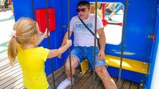 Nastya and dad play fun at the amusement park