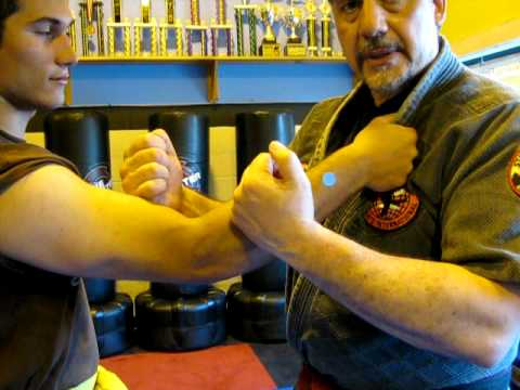 Off a Lapel Grab (Augmented Block, Strikes to Arms & Take Down).AVI