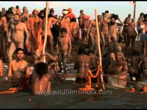 Naga sadhu takes holy dip at Ganga river during Ardh Kumbh