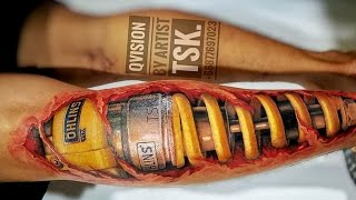 Biker get Tattoo 3D Ohlins Shock on the leg - Great Tattoo