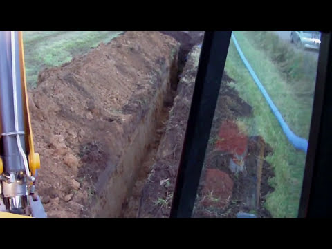 Digging with Terex 980 backhoe seen from the cab