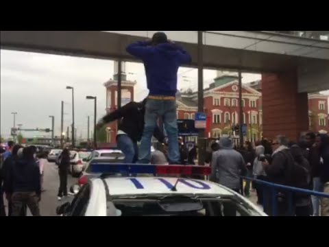 Baltimore protesters damage cars,12 arrested