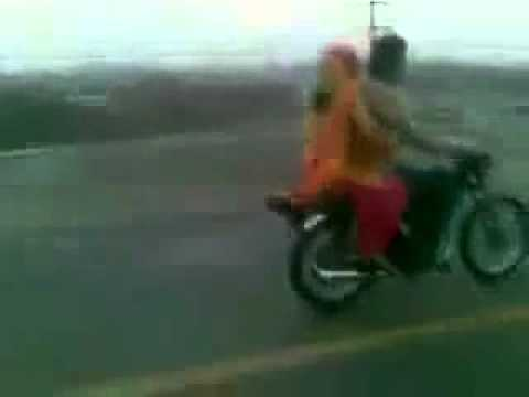 pakistani bike wheeling  with 2 girls