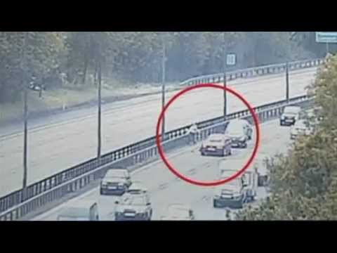 shocking footage: two demented insane women run in front of oncoming traffic on motorway