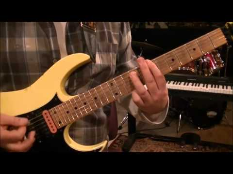 How to play Honky Tonk Man by Dwight Yoakam on guitar