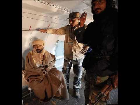ليبيا اعتقال سيف الاسلام القذافي Libya Saif Gaddafi on the plane