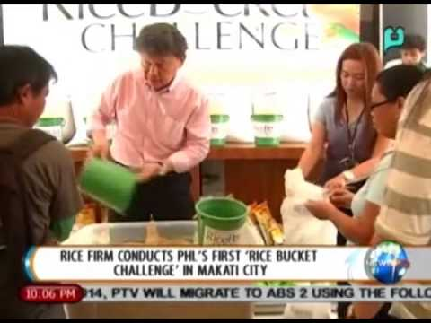 [NewsLife] Rice firm conducts Phl's first 'Rice Bucket Challenge' in Makati city [09|12|14]
