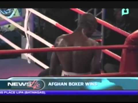 [Champions] - Afghan pugilist triumphs in country's first pro-boxing bout