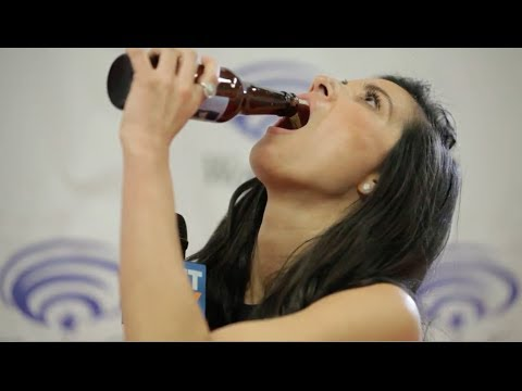 Olivia Munn chugs Joel McHale's beer like a champ