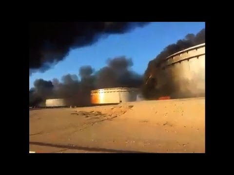Libya oil storage tanks set fire during IS assault