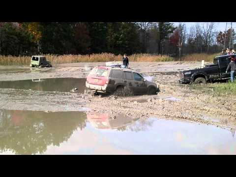 Red Jeep SUV Gets Stuck Mudding