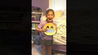 girl is extremely afraid of emojis..