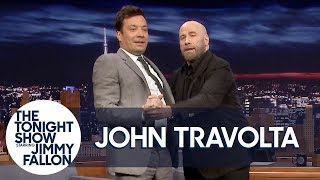 "John Travolta Teaches Jimmy to Tango Like Pitbull's ""3 to Tango"" Music Video"