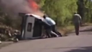 Bystanders jump into action as car catches fire