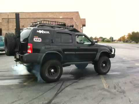 Nissan Xterra Burn out with 35's - YouTube