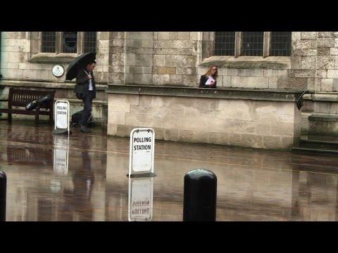 Polls open and rain pours as Britain votes on EU membership