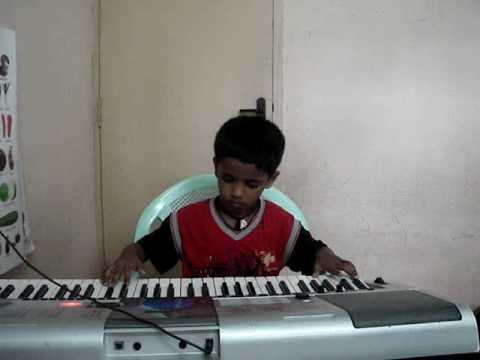 Padmesh Playing Kurai Ondrum Illai Song On Keyboard - This Devotional Song Written By Rajaji video