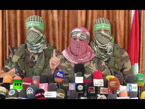 Hamas militants give armed press conference, warn Israel