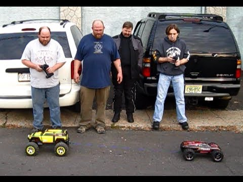 Traxxas Summit VS. Traxxas E-Revo at the Cow RC sponsored INBTY meet at Ultimate RC hobby shop.
