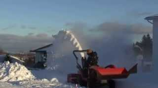 Kubota BX tractor heavy snow clearing after holiday