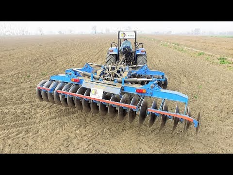 New Holland 7500 with 36 Harrows at Bj farms
