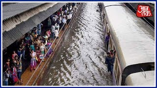 Live: Heavy Rains Lash Andheri, Thane; Railway Services Partially Resume